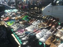 Used shoes at a flea market Stock Images