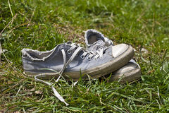 Used shoes in meadow Stock Photo