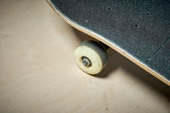 Used skateboard on a wooden background Royalty Free Stock Image