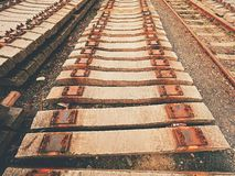 Used sleepers stock in railway depot. Old, dirty and rusty used concrete railway ties stored Royalty Free Stock Photos
