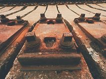 Used sleepers stock in railway depot. Old, dirty and rusty used concrete railway ties stored Stock Photography