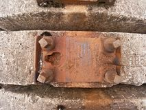 Used sleepers stock in railway depot. Old, dirty and rusty used concrete railway ties stored Royalty Free Stock Images