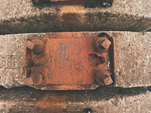 Used sleepers stock in railway depot. Old, dirty and rusty used concrete railway ties stored Stock Photos