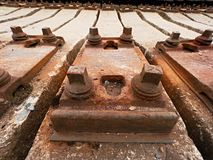 Used sleepers stock in railway depot. Old, dirty and rusty used concrete railway ties stored Stock Images