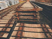 Used sleepers stock in railway depot. Old, dirty and rusty used concrete railway ties stored Royalty Free Stock Photo