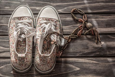 Used  sneakers and necklace Royalty Free Stock Images