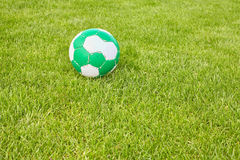 Used soccer ball on grass. Royalty Free Stock Images