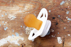 Used soother on wooden background. Used soother on rustic wooden bacground royalty free stock images