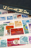 Used stamps and Album with selective focus Stock Image