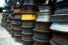 Used and surplus tire rims. Sold at a scrapyard stock photography