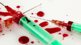 Used syringes and blood. Unhygienic conditions, contagious biohazard stock video footage