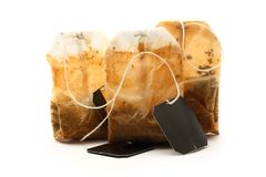 Used tea bag. S with label on white Royalty Free Stock Images