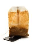 Used tea bag. With label on white Royalty Free Stock Photos