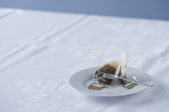Used tea bag on saucer on table Stock Photo