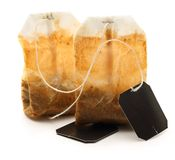 Used tea bags with label. On white Royalty Free Stock Photos