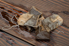 Used teabags. On a wooden background Stock Images