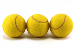 Used tennis balls. Against white background stock images