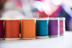 Colorful threads shot with macro lens. Used threads for sewing cloths are shot to show colors and textures in natural light Royalty Free Stock Photos