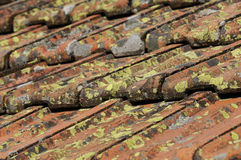 Used tiles. Construction material, roof tiles on a roof covered with foam Royalty Free Stock Images