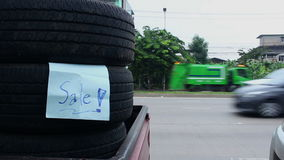 Used Tire for sale. On traffic car stock video