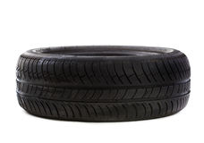 Used tire on white Stock Photography