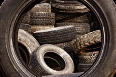 Used tires. Pile of used tires framed by a standing tire Royalty Free Stock Photos