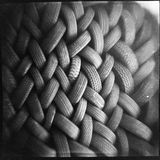 Used tires packed into a woven pattern Royalty Free Stock Image