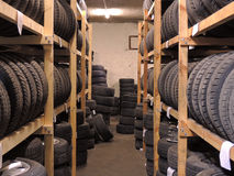 Used tires storage. Used tires depot warehouse with home made wooden shelfs Royalty Free Stock Photos