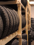 Used tires storage. Used tires depot warehouse with home made wooden shelfs Stock Photo