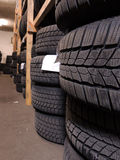 Used tires storage. Used tires depot warehouse with home made wooden shelfs Royalty Free Stock Photo