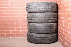 Used tires stored in the garage Stock Image