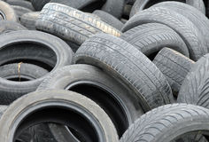 Used tires waiting for recycling. Old abandoned used tires waiting for recycling Stock Photography