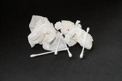 Used tissue and cotton bud Royalty Free Stock Image