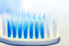 Used toothbrush. Old blue white twotone Royalty Free Stock Photography