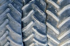 Used tractor tires background. Closeup of old tractor tyre Royalty Free Stock Image