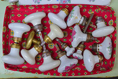 Used traditional European floral white base cabinet door knob Royalty Free Stock Photo