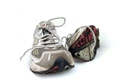 Used Trainers. Pair of used trainers on white background Royalty Free Stock Photos