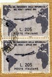 Used and traveled vertical pair of Italian grey Gronchi stamp of worth 205 Lire royalty free stock images