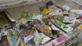 Used tubes from paint in the artist`s workshop. Used tubes from a paint close-up in an art workshop stock footage
