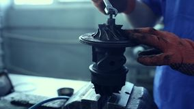 Used turbocharger. Car mechanic hands in garage with old and used turbocharger. Turbine Concept stock footage