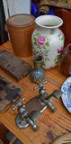Used Twin Old Tap attached together with Vase in Flea Market Stock Image