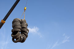 Used tyres hanging on a crane Stock Photography