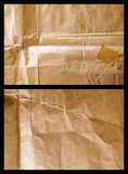 Used up parcel paper 1. Light and shadow on a used up brown wrapping paper sheet with wrinkles stock image