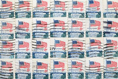 Used US postage stamps. Background of used US postage stamps, close up Stock Image