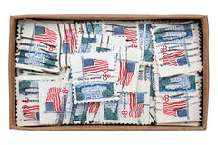 Used US postage stamps. In a cardboard box Stock Photos