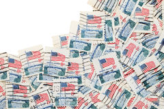 Used US postage stamps. On white background royalty free stock photography