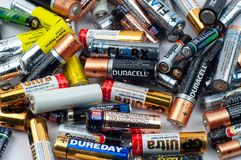 Used different batteries lie in a heap stock photos