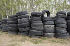 Used vehicle tires. Pile of old, used, worn-out vehicle tires Royalty Free Stock Photography