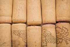 Used vine corks background. Close up of bottle stoppers royalty free stock photos