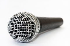 Used vocal microphone on the white background Royalty Free Stock Images
